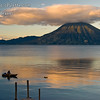 Sunrise and Early morning on Lake Atitlan in Panajachel, Guatemala.  Local fisherman in his boat made of planks.  He did a lot of bailing water.   San Pedro Volcano on far shore.<br /> Guatemala Mission Trip - Day 7 - Thursday, November 15, 2007