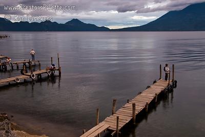 Sunset over Lake Atitlan from Panajachel, Guatemala.  Fisherman on dock.  Flank of Toliman and Atitlan Volcanoes on right. Guatemala Mission Trip - Day 5 -  Tuesday, November 13, 2007