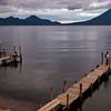 Sunset over Lake Atitlan from Panajachel, Guatemala.  Fisherman on dock.  Flank of Toliman and Atitlan Volcanoes on right.<br /> Guatemala Mission Trip - Day 5 -  Tuesday, November 13, 2007