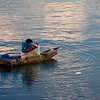 Early morning on Lake Atitlan in Panajachel, Guatemala.  Local fisherman in his boat made of planks.  He did a lot of bailing water.<br /> Guatemala Mission Trip - Day 7 - Thursday, November 15, 2007