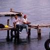 Fishermen on docks at sunset over Lake Atitlan in Panajachel, Guatemala.<br /> Guatemala Mission Trip - Day 5 -  Tuesday, November 13, 2007