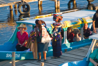 Local vendors selling the wares to passengers waiting to leave on a lake tour in a water taxi. Guatemala Mission Trip - Day 6 - Wednesday, November 14, 2007