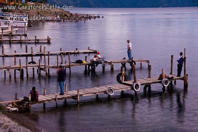 Fishermen on docks at sunset over Lake Atitlan in Panajachel, Guatemala. Guatemala Mission Trip - Day 5 -  Tuesday, November 13, 2007