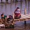 A Guatemalan lady and children at sunset on the dock on Lake Atitlan by Panajachel, Guatemala.<br /> Guatemala Mission Trip - Day 5 -  Tuesday, November 13, 2007