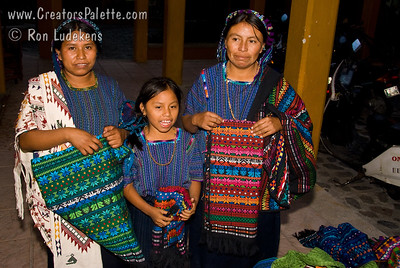Guatemala Mission Trip - Day 2 -  Saturday, November 10, 2007  Sights seen along main market street in Panajachel. I asked permission to photograph these women for a price.  Since I didn't have small change, I ended up buying a table covering from all three.  Since I failed to negotiate well, I think I made their whole week.