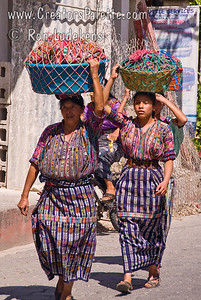 Guatemala Mission Trip - Day 3 -  Sunday, November 11, 2007  The ladies usually are carrying the loads on their heads.  These are merchants bringing their wares to the market street.