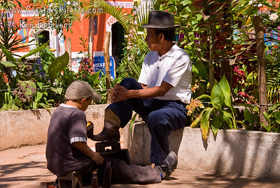 Guatemala Mission Trip - Day 3 -  Sunday, November 11, 2007  Scenes along the walk back from church to our compound by the lake in Panajachel.  Local man getting his shoes shined from a child.