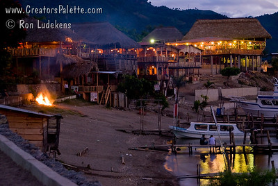 Guatemala Mission Trip - Day 5 -  Tuesday, November 13, 2007 Local resorts and restaurants along shore of Lake Atitlan in Panajachel Guatemala at sunset. Bonfire set on the beach.
