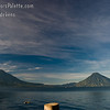Early Morning along shore of Lake Atitlan in Panajachel.   The tiny orange dot in the middle of the photo way off in the distance is one of the 2 bouys the swimmers had to swim around.  Two volcanoes - Toliman in front with Atitlan behind it on left side, San Pedro Volcano on right side.<br /> Guatemala Mission Trip - Day 3 -  Sunday, November 11, 2007