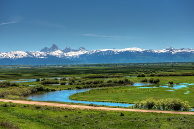 Grand Tetons (west side) with Teton River in the foreground.