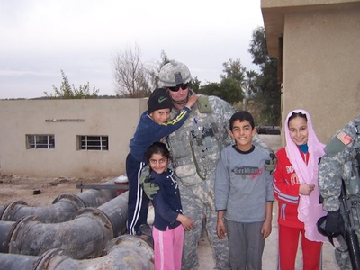 On September 26, 2007 Major Joliat, in Iraq as a Civil Services Officer, was on a humanitarian mission.  Finished for the day, Major Joliat returned to his humvee and as he was getting in he spotted a little girl. He turned to reach for a doll to give to the child and it was then that he took a bullet in the arm ... a bullet that would have proven fatal had he not been reaching for the doll.