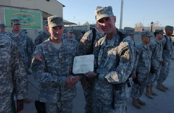 While on his second tour in Iraq, (he also served one tour in Afghanistan), Major Herbert A. Joliat was awarded the 'Bronze Star Medal' and the 'Army Commendation Medal with Valor' for valorous acts while assisting with the medical treatment of a soldier in Tarmiyah, Iraq. Major Joliat's actions and efforts as a leader assisted in saving the life of a fellow soldier, providing medical aid to two critically wounded Iraqi interpreters and extinguishing the engulfing flames of a burning M1114 to recover the body of a fallen comrade. While under enemy fire during a catastrophic IED attack, his calm and collected performance under intense combat stress and pressure inspired his patrol to take action and reflects great credit upon him, the 1st Special Troops Battalion Brigade and the United States Army.