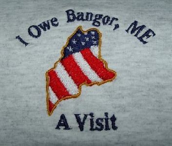 The T-shirt logo incorporates an outline of the State of Maine overlaid by the stars and stripes which is the official logo of Mainetroopgreeters.com as designed and generously donated by Kenneth Kroesser. We would also like to thank 'Cutlers Embroidery' of Bangor for assisting us with the t-shirt design.