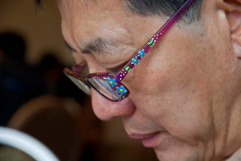 Ed Ngan and his wife's reading glasses.