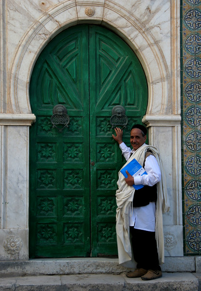 Mohamed, our guides takes us to a mosque in the Old City Medina.