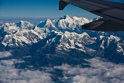 Monday, Nov 14, 2011, flying to Lhasa on China Air. Mt Everest is center, just below wingtip.