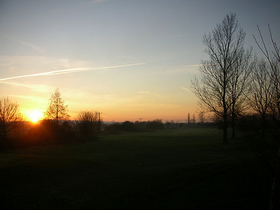 Sunset on the golf course after a round in the winter sun