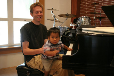 JC and Schroeder, our newest worship team member learns to play piano (just missed catching him playing)