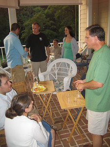 Bryan and Julie enjoy a chat with Pastor George at the Mosaic Worship Arts party, 9/2006.