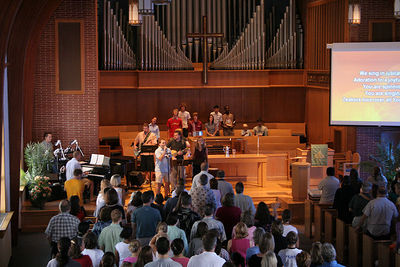 The worship team leads singing during a contemporary service, 2005