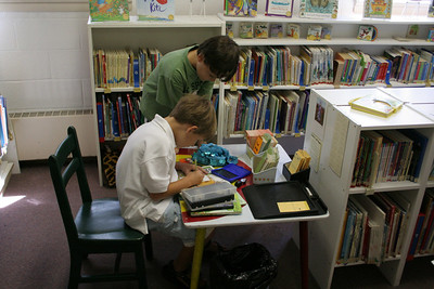 2 boys check out books from the children's library photo taken 8/2006