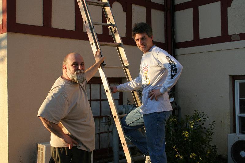 Brad & Tim repair gutters. photo taken 1/2007 (Tim is a volunteer)