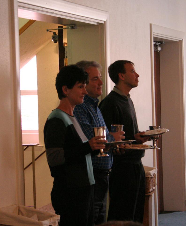 Several elders prepare to serve communion