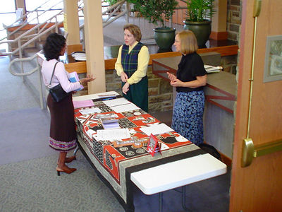 a missions information table set up in the concourse