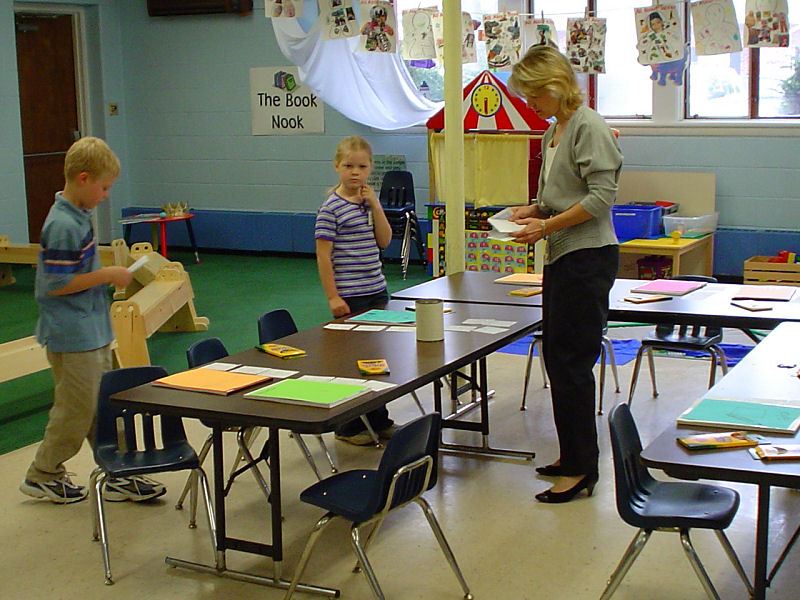 Children's Ministries - helpers of all ages prep for class