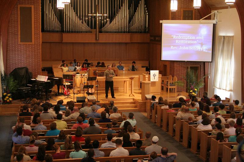 Pastor Schmidt preaching, mosaic service, 2005