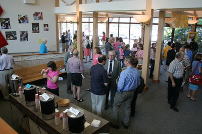People getting coffee and tea and mingling in the concourse between services. 9/2006.