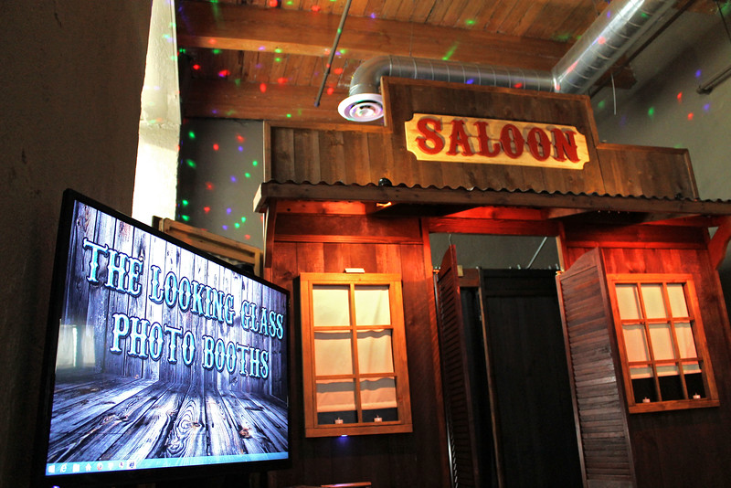 Our Rustic Western Saloon Photo Booth.  https://thelookingglassphotobooths.com/