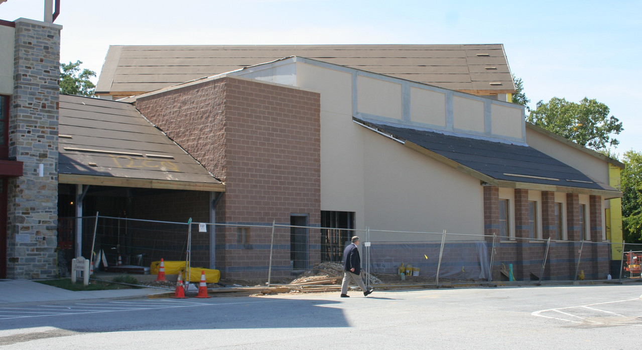 9/30/2007: Worship Center, outside view, northern side.  More work has been done on the roofing and outside walls, including masonry, stucco, painting, etc.