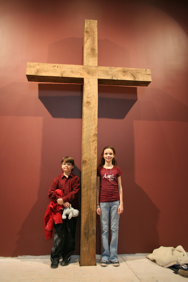 1/20/2008: our new cross, made of wood from the old oak tree that stood almost where this is now.  These two children are grandchildren of Mark Harp, who had planted the oak tree many years ago.