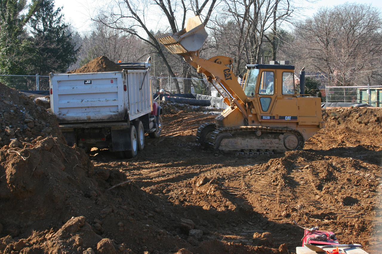 1/11/2007: This loader is kept busy loading 2? dump trucks that shuttle the dirt to the back lot, where a bulldozer spreads it.