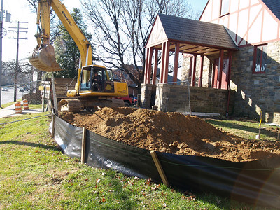 1/4/2007: excavation in the 'H' between the sanctuary and the  loft. (York Rd side)   This scoop is loading from the pile into 2 dump trucks, which take the dirt to the back lot where it is spread to improve that part of our property.