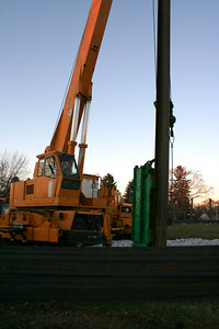 12/23/2006: a beam driver, pounds the steel beams into the ground.