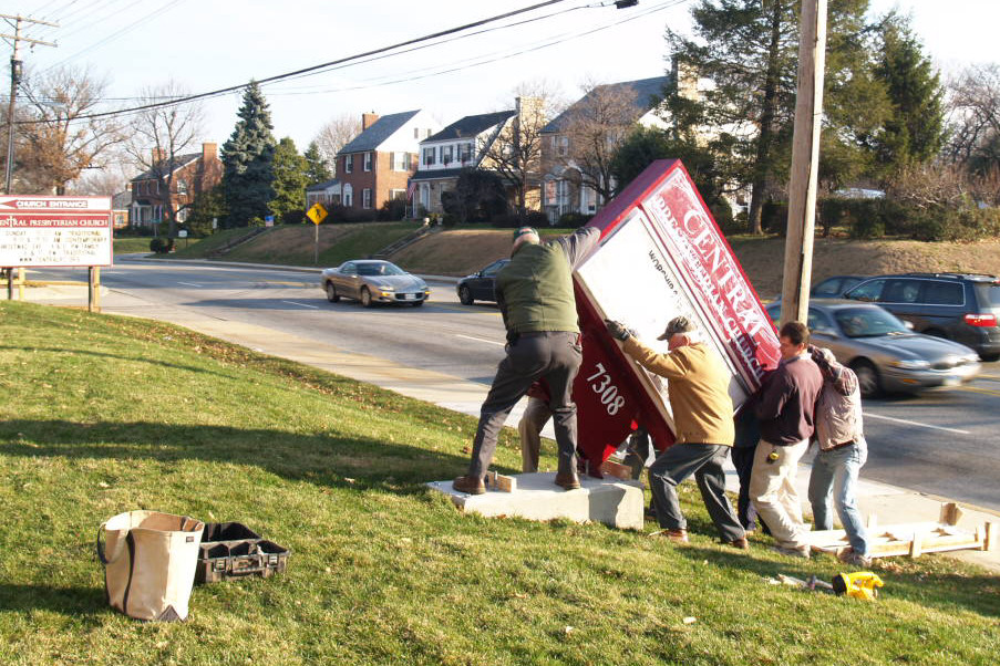 12/20/2007: installing the new sign along York Rd. (our own version of the Marines at Iwo Jima)