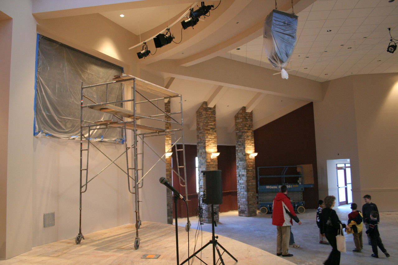 1/20/2008: stage, the unfinished square is where one of the backlit projection screens will be installed.  speakers and lighting can be seen overhead.