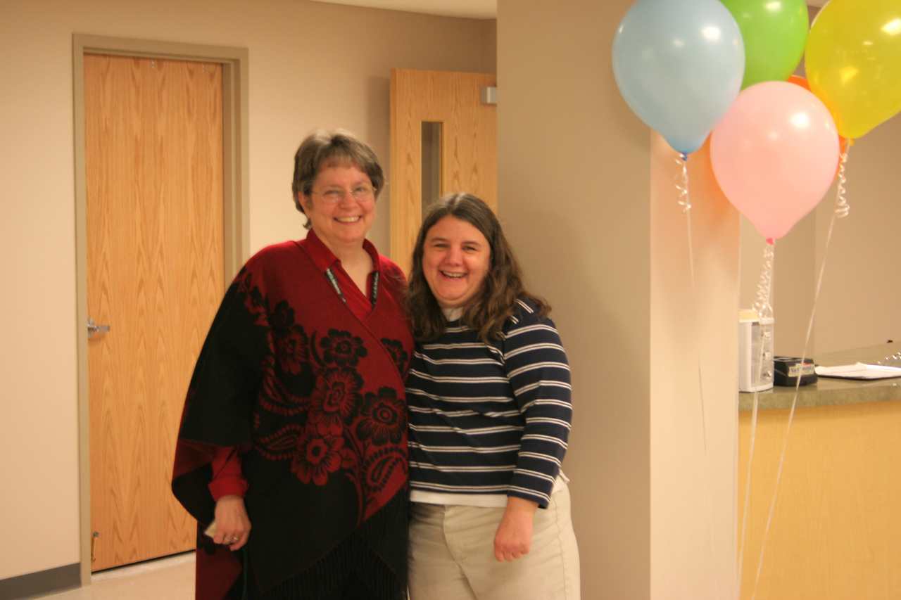 12/16/2007: Anne and Sue by the welcome desk in the new infant & toddler nurseries area -- which just opened for our use this Sunday!