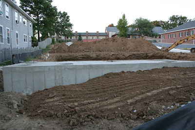 8/21/2006 view from stevenson lane. Here is the completed concrete drainage container, and 2nd hole being dug uphill from it.