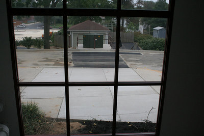 9/23/2006, the transformer pad, street and sidewalk are (mostly) finished, No more big hole!