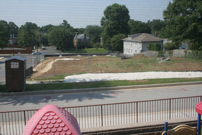 7/9/2006: view of lot after initial fencing added, stumps ground, etc.