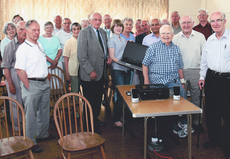 """This photographn (taken by Alan Chippett)  records the handing over of the new computer and projector to the Club on 12th June 2007. It shows Kelly Lean, Harlow's Arts Development Officer presenting the equipment to some of the Club's members. With the backing of Harlow Arts Council the Club received a total of £3,132 from the """"Awards for All"""" Lottery Fund to purchase equipment to help in the ongoing activities of the Club."""