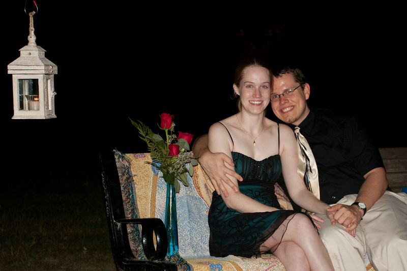 The bench was lit by a small candle lantern, was covered by a soft blanket and there were three roses in a blue (Katie's favorite color) vase.  It was here that David got down on one knee and proposed.  Howard and I were waiting in a car back in a parking lot.  When David texted us that he and Katie were engaged we came over to get some photos.  As you can probably tell, Katie was pretty emotional.
