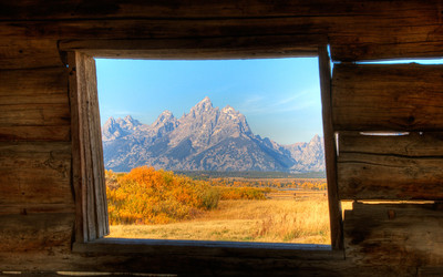Framing the Tetons from inside old cabin.