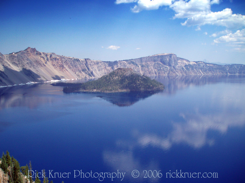 Eileen's early (approx 7 am) photo of Crater Lake and perfectly clear reflection of the sky and clouds taken from our room at the Crater Lake Lodge.<br /> <br /> P7260526-CraterLakeCloudReflections-2 copy.jpg