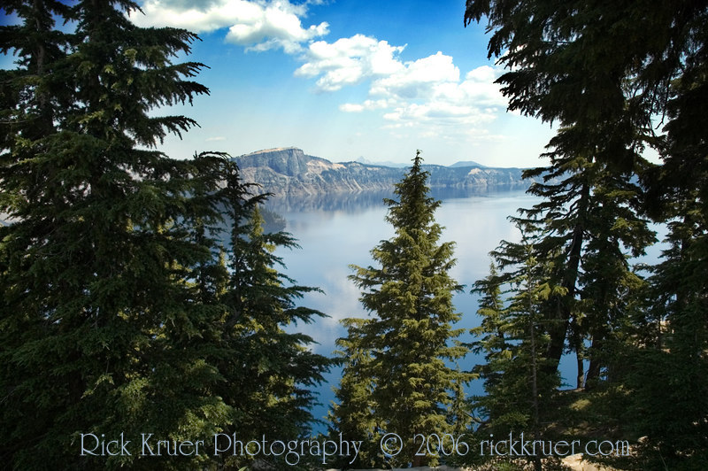 Landscape photo of Crater Lake in late morning on a beautiful clear day. Taken looking toward the north near Sinnot Memorial Outlook.<br /> <br /> ND70_2006-07-27DSC_6182-CraterLakeTreesNearSinnottOverlook-3 copy.jpg