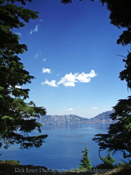 Eileen's scenic photo of Crater Lake, OR through the tall pines from Merriam Point on the west side of the lake near the North Entrance of Rim Drive. Photo taken looking toward the east.<br /> P7250488-CraterLakeTallMerriamPoint-2 copy.jpg