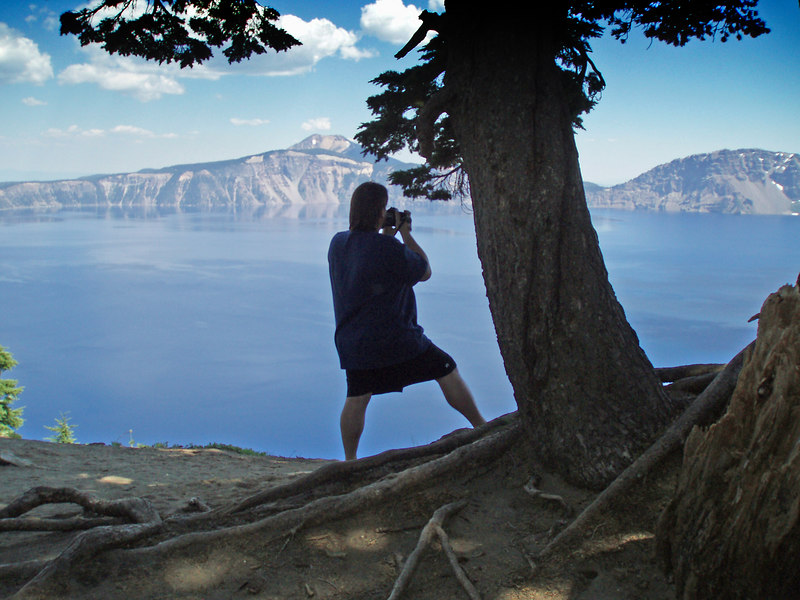 Sillouette of Rick taking photos on the west side of Crater Lake, OR looking toward the east.<br /> P7250496-RickSillouetteCraterLakeMerriamPoint-2 copy.jpg